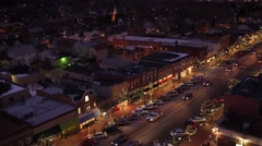 Aerial shot of small town USA during Christmas season at night Stock Footage