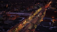 Aerial shot of small town USA during Christmas time at night Stock Footage
