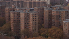 Flying close past apartment buildings of New York's East Side Projects. Shot in Stock Footage