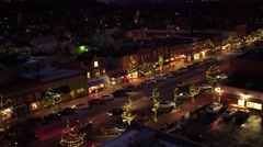 Fly by  of small town main street during Christmas time   at night Stock Footage