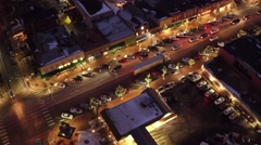 Stunning shot of small town USA during Christmas at night from the air Stock Footage