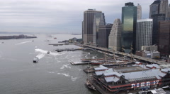 Flying along the East River from Pier 17 past the Financial District toward Stock Footage