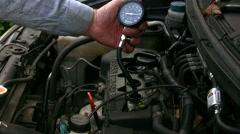 Engine cylinder compresion test, remove gauge Stock Footage