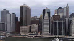 Flying past New York Financial District toward Battery Park. Shot in 2011. - stock footage