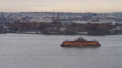 Staten Island Ferry on Hudson River passing Brooklyn with Financial District Stock Footage