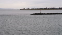 Approaching and flying over jetty near Stratford, Connecticut; Stratford Point - stock footage