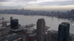 Flying past skyscrapers of Jersey City, looking across Hudson to New York City. Stock Footage