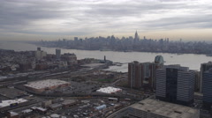 Flying over Jersey City, Midtown Manhattan skyline in background. Shot in 2011. Stock Footage