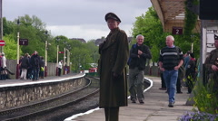 Reenactors in WWII uniform at Ramsbottom station - stock footage