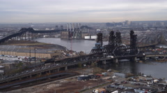 Over bridges on the Passaic River in Jersey City, heading toward heliports. Shot Stock Footage
