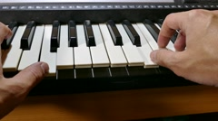 Playing man hand synthesizer music piano run keys over Stock Footage