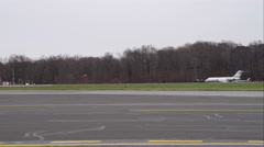 Planes on runway at Westchester County Airport in Greenwich, Connecticut. Shot Stock Footage