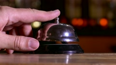 Man arm pushes call bell at hotel Stock Footage