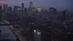 Flying along East River toward Manhattan Bridge at dusk, Manhattan skyline at Stock Footage
