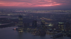 Over the Hudson at dusk, looking toward Jersey City skyline. Shot in 2011. Stock Footage