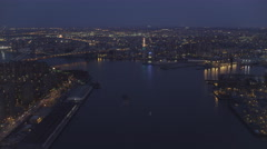 High over East River with Williamsburg Bridge in background, rotating to look Stock Footage