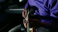 Man playing electric guitar recording studio pulls strings Stock Footage