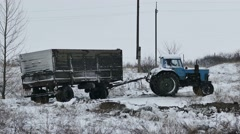 Tractor trailer slips stuck in snow on the road winter - stock footage