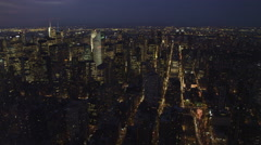 Flying over Upper Manhattan at dusk, Hudson River in background. Shot in Stock Footage