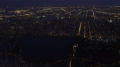 Over Central Park in New York City at night, looking toward Upper East Side and Stock Footage