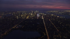 Over Central Park at dusk, looking toward Times Square and Lower Manhattan; Stock Footage