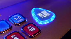 Close up woman pressing play button on slot machine inside Hard Rock Casino Stock Footage