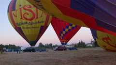 Hot air balloons being heated up Stock Footage