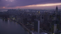 Over East River, approaching New York Financial District at dusk. Shot in Stock Footage