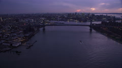 Over the East River, approaching Williamsburg Bridge at dusk. Shot in November Stock Footage