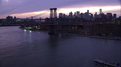 Over Williamsburg Bridge on the East River, Manhattan Financial District in Stock Footage