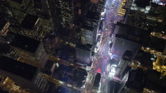 Flying southeast over Times Square at night, heading toward Rockefeller Center. - stock footage