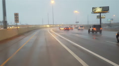 POV-Driving express lane on rainy freeway at dusk with headlights - stock footage