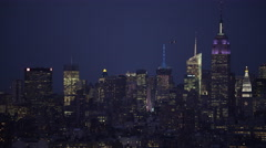 Crossing Manhattan at night, looking toward Midtown; a helicopter circles in Stock Footage