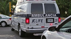 Ambulance car at the street road with blinking lights - stock footage