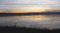 From the window of a train on the Lake at sunset Stock Footage