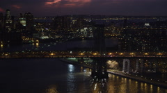 Stock Video Footage of Williamsburg Bridge at night, New York City Financial District beyond. Shot in