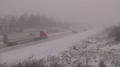 Blizzard and snowstorm on the highway with traffic cars and transport trucks Stock Footage