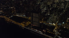 Above New York's East River at night, UN Building in foreground. Shot in - stock footage