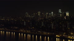 Flying south along the East River at night, Financial District in background. Stock Footage