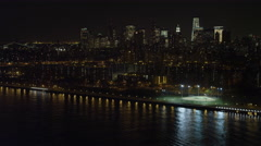 Flying south along the East River toward Williamsburg Bridge at night, New York Stock Footage