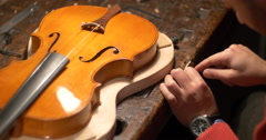 Violin maker Cine 4k [External audio] - patience Stock Footage