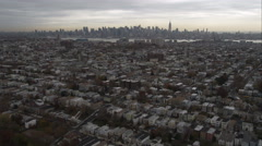 Flying toward New York City skyline over residential area in Jersey City, New - stock footage