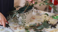 Florist at work. Woman making bouquet Stock Footage