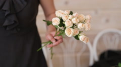 Florist at work. Woman making bouquet - stock footage