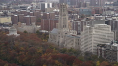 Flying past Riverside Church, Grant's Tomb at left in Riverside Park on New York - stock footage