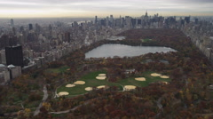 Over Central Park and turning east. Shot in November 2011. Stock Footage