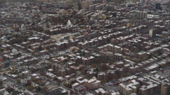 Flying over Flushing in Queens, New York, City, zoom-out to wider view. Shot in Stock Footage