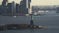 Flying by the Statue of Liberty in hazy daylight. Shot in 2011. Stock Footage