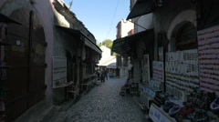 Stock Video Footage of People walking on a narrow street with small shops in Mostar, Bosnia-Herzegovina