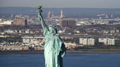 Orbiting the upper half of the Statue of Liberty, Jersey City in background. Stock Footage